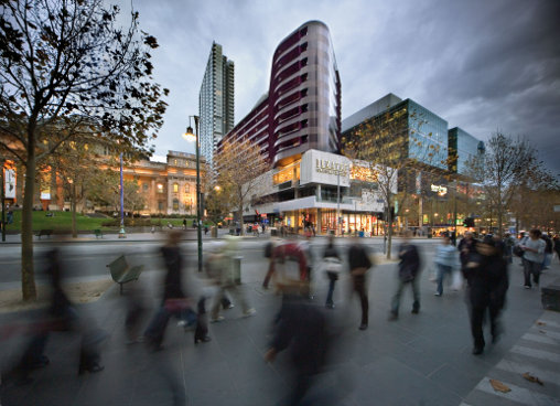 A view across Melbourne's Swanston Street to the QV complex which integrates shopping, dining and living experiences.