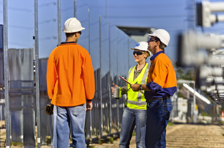 Engineers discuss the position of solar reflectors at the CSIRO National Solar Energy Centre.